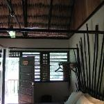 Aracari Room with Amazing headboard and thatch roof