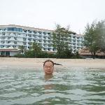 Swimming in the sea with the hotel in the background