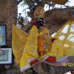 An Idol of Krishna beneath the tree where he hid the clothes of the Gopi bathing in Yamuna