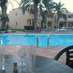 Dinner outside restaurant by pool