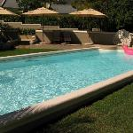 Large pool with sun loungers, towels and pool toys