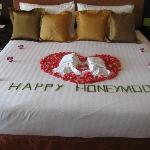Welcome flowers arranged on bed
