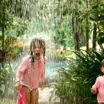 Our kids under the Laguna's rain shower