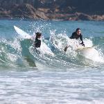 Surfers off Zurriola beach