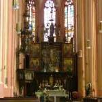Main altar in the ealry gothic interior of St Moritz church