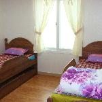 """2 of us were given a """"Family Room"""", which is divided into 2: this side has two single beds"""