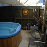 private courtyard with outdoor spa pool unit