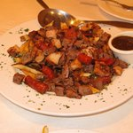 Carne a la Brasa – Huge portion of mixed grilled beef, chicken, Spanish sausages and French frie