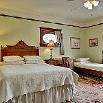 Cozy guestrooms with queen beds, private bathrooms, and comfy linens.  Oriental rugs, antique fu