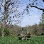Seats overlooking meadow and lake