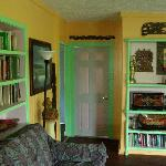 Shared living room has a large reading selection