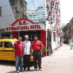 In front of the hotel with dad and friend