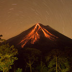 Volcano at night from room showing star trails (30 min exposure)