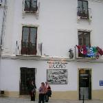 Hotel front with football flags and fans