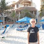 On the beach with the hotel behind my wife