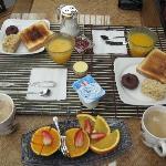 Simple but delightful & refreshing breakfast. Great coffee, too! Cheers!