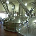 The factory is spotless; here the brewing tanks are polished to a shine.