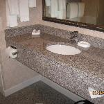 Very clean bathroom w/ lots of marble and granite