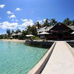The longhouse, beach and villas down the shore
