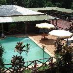 Balcony overlooks the pool and restaurant/bar