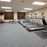 Large fitness room, pool, whirlpool, courtyard patio with BBQ grills and more to make you feel r