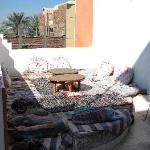 Sitting outdoor lounge with rugs and cushions just outside our room.