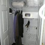 Closet with safe, iron/ironing board and extra linens