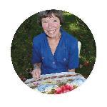 Our artisan, Carol, making a wonderful piece of rug art.