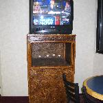 strand board TV stand- note the TV-less wall mount behind