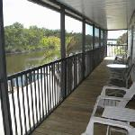 Relax on the screend balcony of waterfront homes