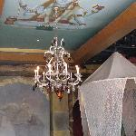 Painted ceiling and canopies around tables