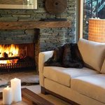 Relax by the fire after an active day trout fishing, skiing or tramping in the nearby World Heri