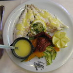 dorade with lemon sauce and vegetables under winagre