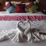 King bed with folded towels in swan shape