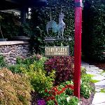 Chanticleer Inn sign in front of the river stone porch.