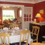 Almara Breakfast Room surrounded with quiet Irish music,overlooking waterfall in landscaped gard