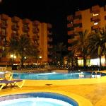Pool and courtyard at night