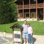 Wife and I at sign in front of Inn