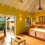 The 36 air-conditioned cottage accommodations are spread across 30 acres of lawns, palm trees, a