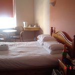 room was spacious with a comfy bed and small table and 2 chairs by window!