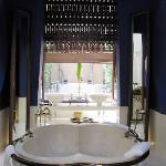 beautiful bathtub sets the drama for the room