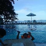 my niece and son swimming in bahay bakasyunan sa Camiguin Pool
