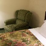 one of the beds and reclining chair