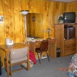 table & chairs, desk, tv, fridge
