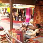A carpet shop-owner spends a leisure moment