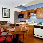 Our convenient and comfortable suites, featuring full kitchens and living rooms with fireplaces,