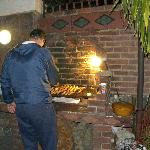 Barbecue being prepared for the guests.