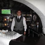 Pierre - the bartender who makes your complimentary Pisco Sour