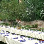The tables surrounded by lilacs!
