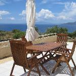 It doesn't get any better than this! Patio set overlooking the sea.